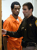 Manassas, VA - November 13, 2002 -- John Allen Muhammad is escorted into the Prince William Circuit Court,  as he makes an appearance before Judge Leroy F. Millette for an hearing to appoint counsel where he is charged with the October 9, 2002 slaying of Dean Meyers in Manassas, Virginia, Wednesday November 13, 2002.  .Credit: Jahi Chikwendiu - Pool via CNP