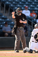 Home plate umpire Seth Buckminster during an Arizona Fall League game between the Surprise Saguaros and Salt River Rafters on October 14, 2013 at Surprise Stadium in Surprise, Arizona.  Salt River defeated Surprise 3-2.  (Mike Janes/Four Seam Images)