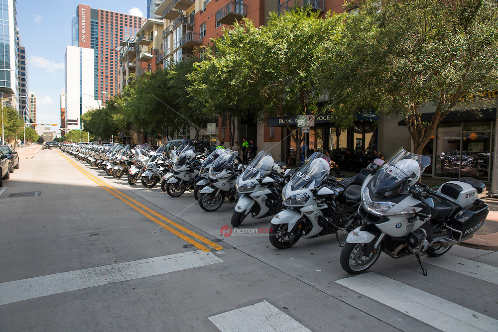 Austin, Texas - Tues., August 23, 2016: Austin Police Department motorcycles line 2nd street as far as the eye can see during Republican presidential candidate Donald Trump taping of a two-hour interview with Fox News host Sean Hannity at ACL Live at The Moody Theater in downtown Austin, Texas.<br />