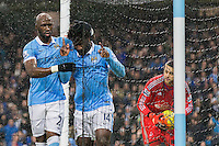 Wilfried Bony celebrates scoring his sides first goal with  Eliaquim Mangala during the Barclays Premier League Match between Manchester City and Swansea City played at the Etihad Stadium, Manchester on 12th December 2015