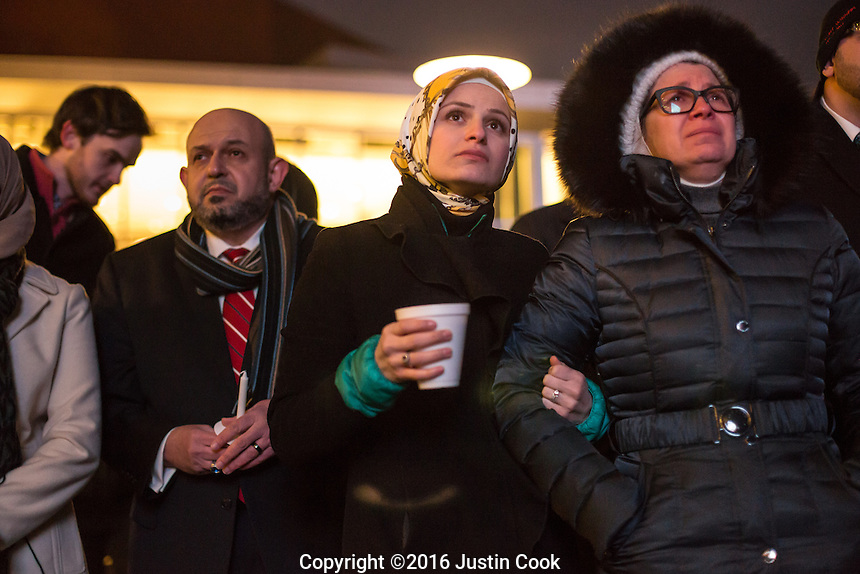 Suzanne Barakat (center) and her mother Layla Barakat (right) on the one-year anniversary of the murder of her brother Deah Barakat, his wife Yusor Mohammad Abu-Salha and her sister Razan Mohammad Abu-Salha (ALL NAMES CQ). Yusor and Razan's father, Dr. Mohammad Abu-Salha, is at left. A vigil was held in their honor at North Carolina State University in Raleigh, NC on Wednesday, February 10, 2016. (Justin Cook)