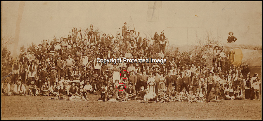BNPS.co.uk (01202 558833)Pic: HeritageAuctions/BNPS<br /> <br /> ****Please use full byline****<br /> <br /> (Circled stood) Annie Oakley. (Circled sat)Buffalo Bill with Nate Salsbury to his right. Behind them, along with cowboy Tom Webb is little Benny Irving, half Lakota and &quot;the smallest cowboy in the world,&quot; and the camp matron, Ma Whitaker. Up to the left is the giant cowboy Dick Johnson with a big stogie in his mouth. Buffalo Bill's daughter Arta is seated at the left. About the same distance to the right is Sioux chief Red Shirt and at the top of the pyramid, standing above Johnny Baker, is Sgt. Bates with his Stars and Stripes. <br /> <br /> A 130-year-old shotgun once wielded by famed Wild West gunslinger Annie Oakley has emerged for sale for &pound;60,000.<br /> <br /> Oakley was just 25 when she shot to fame as the top attraction in Buffalo Bill Cody's travelling Wild West show, drawing crowds with her incredible shooting skills.<br /> <br /> The 1883 16-gauge Parker hammer shotgun is thought to be Oakley's first proper gun and came to be one of her favourites.