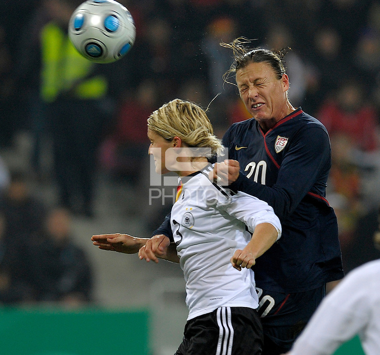 Abby Wambach (20) heads he ball over Saskia Bartusiak for the goal. US Women's National Team defeated Germany 1-0 at Impuls Arena in Augsburg, Germany on October 29, 2009.