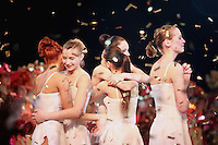 """Deriugina School gymnasts of Ukraine celebrate finish of gala exhibition  after 2007 World Cup Kiev, """"Deriugina Cup"""" in Kiev, Ukraine on March 18, 2007. Visible is Irina Kovalchuk (2nd from left)...with others."""