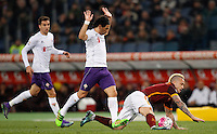 Calcio, Serie A: Roma vs Fiorentina. Roma, stadio Olimpico, 4 marzo 2016.<br /> Roma&rsquo;s Radja Nainggolan, right, is fouled by Fiorentina&rsquo;s Tino Costa  during the Italian Serie A football match between Roma and Fiorentina at Rome's Olympic stadium, 4 March 2016.<br /> UPDATE IMAGES PRESS/Riccardo De Luca
