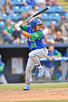 Lexington Legends shortstop Cristian Perez (15) swings at a pitch during a game against the Asheville Tourists at McCormick Field on May 25, 2018 in Asheville, North Carolina. The Tourists defeated the Legends 6-4. (Tony Farlow/Four Seam Images)