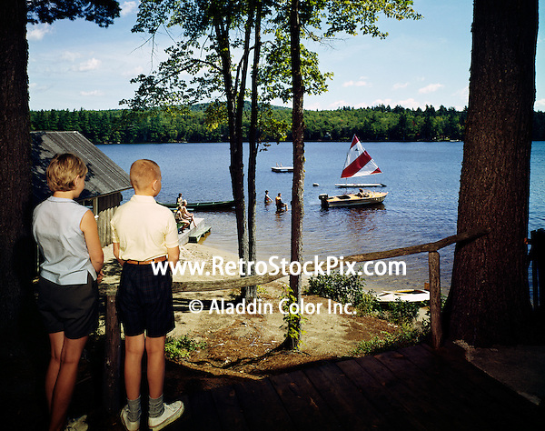 Bethel Inn. Boy & girl stand above the lake watching a sailboat