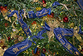 "The 2018 White House Christmas decorations, with the theme ""American Treasures"" which were personally selected by first lady Melania Trump, are previewed for the press in Washington, DC on Monday, November 26, 2018.  Detail of the decorations on the Official White House Christmas tree in the Blue Room. <br /> Credit: Ron Sachs / CNP"