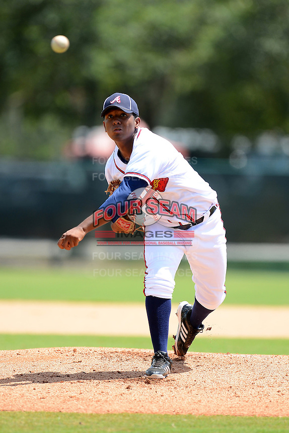 GCL Braves pitcher Oriel L. Caicedo (11) during a game against the GCL Blue Jays on July 15, 2013 at Disney's Wide World of Sport in Orlando, Florida.  The game was called in the 4th inning due to rain storms with the Braves leading 5-0.  (Mike Janes/Four Seam Images)