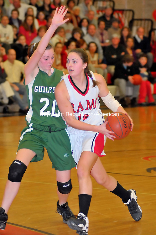 CHESHIRE, CT-15 FEBRUARY 2009-021510JS03-Cheshire's Lauren Hague (15) looks to drive past Guilford Courtney Miller (20) during their game Monday at Cheshire High School. <br /> Jim Shannon Republican-American