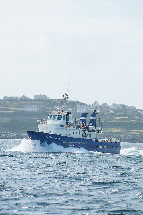 Happy Hooker, Inishmore, Aran Islands. Doolin ferries Happy hooker ferry en route from Inishmore to Doolin.