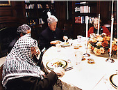 The Working Dinner at The Washington Summit at Wye River on Saturday, October 17, 1998.  Pictured left to right: Palestinian Authority Chairman Yasser Arafat; Gamal Helal, The Interpreter; United States President Bill Clinton; United States Secretary of State Madeleine Albright..Mandatory Credit: White House via CNP