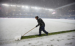 Groundstaff trying to clear the lines at Ibrox Stadium