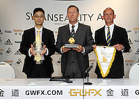 Pictured L-R: Albert Sin Goldenway Precious Metal operation manager, chairman Huw Jenkins, Darren Vickers, Goldenway UK director at the official launch of the 2013-2014 Swansea City Football Club kit launch at the Liberty Stadium, Swansea, south Wales. Friday 28th of June 2013