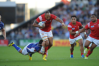 Vungakoto Lilo of Tonga is tackled by Rohan Kitshoff of Namibia during Match 20 of the Rugby World Cup 2015 between Tonga and Namibia - 29/09/2015 - Sandy Park, Exeter<br /> Mandatory Credit: Rob Munro/Stewart Communications