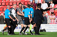 Lincoln City's first team coach Jamie McCombe speaks to Referee Carl Boyeson at the end of the game<br /> <br /> Photographer Chris Vaughan/CameraSport<br /> <br /> The EFL Sky Bet League One - Lincoln City v Bristol Rovers - Saturday 14th September 2019 - Sincil Bank - Lincoln<br /> <br /> World Copyright © 2019 CameraSport. All rights reserved. 43 Linden Ave. Countesthorpe. Leicester. England. LE8 5PG - Tel: +44 (0) 116 277 4147 - admin@camerasport.com - www.camerasport.com