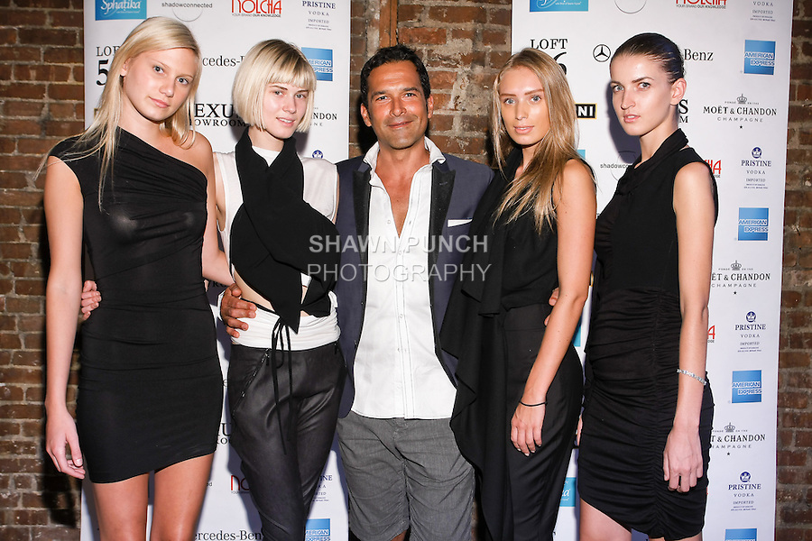 Roberto Dugarte poses with models during the Shadowconnected S/S 11 presentation at Nexus Showroom, September 2nd, 2010.