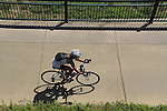 Woman riding bike in Confluence Park, Denver, Colorado .  John offers private photo tours in Denver, Boulder and throughout Colorado. Year-round.