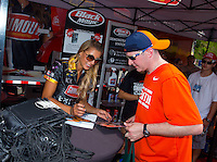Jun 19, 2015; Bristol, TN, USA; A fan getting a hero card autographed by NHRA top fuel driver Leah Pritchett during qualifying for the Thunder Valley Nationals at Bristol Dragway. Mandatory Credit: Mark J. Rebilas-