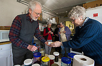 NWA Democrat-Gazette/BEN GOFF @NWABENGOFF<br /> Kent Kerr of Gravette helps Connie Sanders of Tontitown dye her egg Friday, March 22, 2019, during a Ukrainian Easter egg decorating class at the Gentry Senior Activity Center. Kerr, with wife Joyce Kerr, lead the class on decorating eggs using wax to make designs and dips into multiple colors of dye to create eleborate designs. The senior activity center holds a craft making class each Friday.