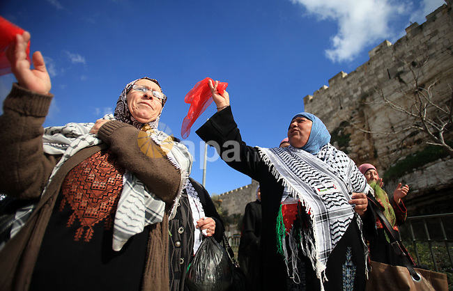 Palestinians participate in a simulated wedding marking the International Women's Day, in Jerusalem's Old City March 10, 2014. Photo by Saeed Qaq