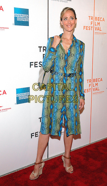 """KIM RAVER.Attends the premiere of the new film, """"Slingshot"""",  at the Tribeca Film Festival in downtown Manhattan, New York, USA, 26th April 2005..full length turquoise blue green snakeskin print belted shirt dress bag.Ref: ADM.www.capitalpictures.com.sales@capitalpictures.com.©Patti Ouderkirk/AdMedia/Capital Picture."""