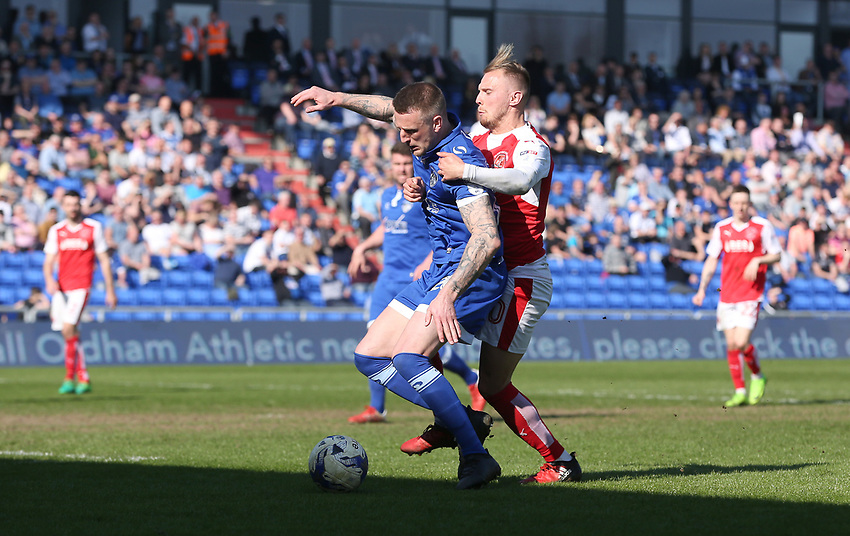 Oldham Athletic's Peter Clarke shields the ball from Fleetwood Town's David Ball<br /> <br /> Photographer Stephen White/CameraSport<br /> <br /> The EFL Sky Bet League One - Oldham Athletic v Fleetwood Town - Saturday 8th April 2017 - SportsDirect.com Park - Oldham<br /> <br /> World Copyright &copy; 2017 CameraSport. All rights reserved. 43 Linden Ave. Countesthorpe. Leicester. England. LE8 5PG - Tel: +44 (0) 116 277 4147 - admin@camerasport.com - www.camerasport.com