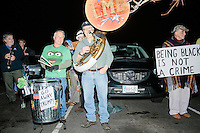 Members of the Leftist Marching Band perform with anti-Trump protesters gather near the Sheraton Portsmouth Harborside Hotel in Portsmouth, New Hampshire, USA. At the hotel later that evening, Republican presidential candidate and real estate mogul Donald Trump received an endorsement from the New England Police Benevolent Association executive council. Many protesters expressed disagreement with Trump's recent statements that he would ban all Muslims from entering the country. Trump brought up the recent shooting in San Berdardino, Calif., at the meeting. A small group of perhaps 20 Trump supporters stood outside the hotel. One of the protest organizers estimated that there were around 230 protesters gathered.
