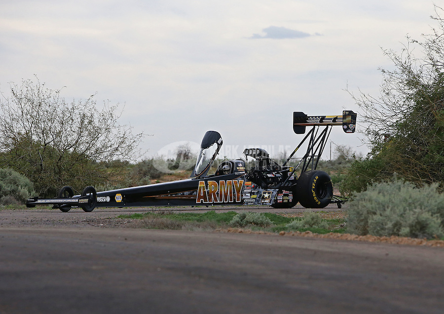 Feb 22, 2015; Chandler, AZ, USA; NHRA top fuel driver Tony Schumacher is pushed off the track after winning the Carquest Nationals at Wild Horse Pass Motorsports Park. Mandatory Credit: Mark J. Rebilas-