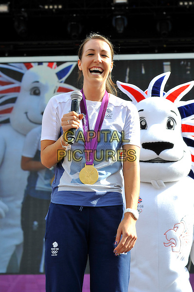 Dani King.Gold Medal Winner for Team GB, attending BT London Live, Hyde Park, London, England. .5th August 2012.cyclist half length white t-shirt blue tracksuit smiling medal microphone athlete.CAP/MAR.© Martin Harris/Capital Pictures.