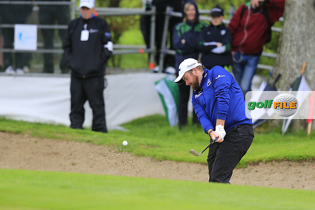 Shane Lowry (IRL) chips from a bunker at the 17th green during Thursday's Round 1 of the 2016 Dubai Duty Free Irish Open hosted by Rory Foundation held at the K Club, Straffan, Co.Kildare, Ireland. 19th May 2016.<br /> Picture: Eoin Clarke | Golffile<br /> <br /> <br /> All photos usage must carry mandatory copyright credit (&copy; Golffile | Eoin Clarke)