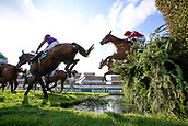 14h April 2018, Aintree Racecourse, Liverpool, England; The 2018 Grand National horse racing festival sponsored by Randox Health, day 3;  Horses successfully negotiate the water jump during the Grand National