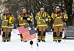 Members of the Ellington Volunteer Fire Department cover their hearts during taps, during a Wreaths Across America event, Saturday, December, 16, 2017, at the Ellington Center Cemetery in Ellington. The local event was sponsored by the Ellington Fire Department who places more than 100 wreaths on the graves of veterans. from left, they are, firefighter Tom Adams, firefighters and former fire chief's Michael Varney and Jack Turner and the present fire chief Gary Feldman.  (Jim Michaud / Journal Inquirer)