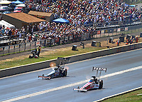 Jul. 20, 2014; Morrison, CO, USA; NHRA top fuel driver Steve Torrence (near lane) races alongside Steve Chrisman during the Mile High Nationals at Bandimere Speedway. Mandatory Credit: Mark J. Rebilas-