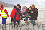 3735-3741.Jer Purcell and Pat Murphy lifts baby Allanah in her buggy and Cian Purcell after a large wave came inshore at the Irish Seal Sanctuary release of 'Sammy' at Rossbeigh beach on Saturday