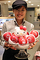 "September 28, 2016, Tokyo, Japan - Japan's Mitsukoshi department store sales clerk displays apples printed with Japan's famous kitten character Hello Kitty, produced in Aomori at the department store in Tokyo on Wednesday, September 28, 2016. Mitsukoshi started promotion of food products with Hello Kitty characters ""Hello Kitty Fair"" at their food floor through October 11.   (Photo by Yoshio Tsunoda/AFLO) LWX -ytd-"