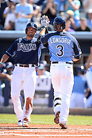 Tampa Bay Rays third baseman Evan Longoria (3) is greeted by David DeJesus (7) after hitting a home run during a spring training game against the Minnesota Twins on March 2, 2014 at Charlotte Sports Park in Port Charlotte, Florida.  Tampa Bay defeated Minnesota 6-3.  (Mike Janes/Four Seam Images)