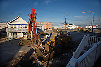 Heavy machinery is seen cleaning streets after Hurricane Sandy hit town one month ago in Seaside Heights, New Jersey, November 28, 2012.