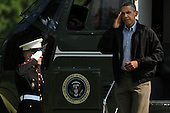 United States President Barack Obama (R) salutes a US Marine as arrives on the South Lawn of the White House by Marine One, in Washington DC, USA, Sunday, 10 July 2011. .Credit: Michael Reynolds / Pool via CNP