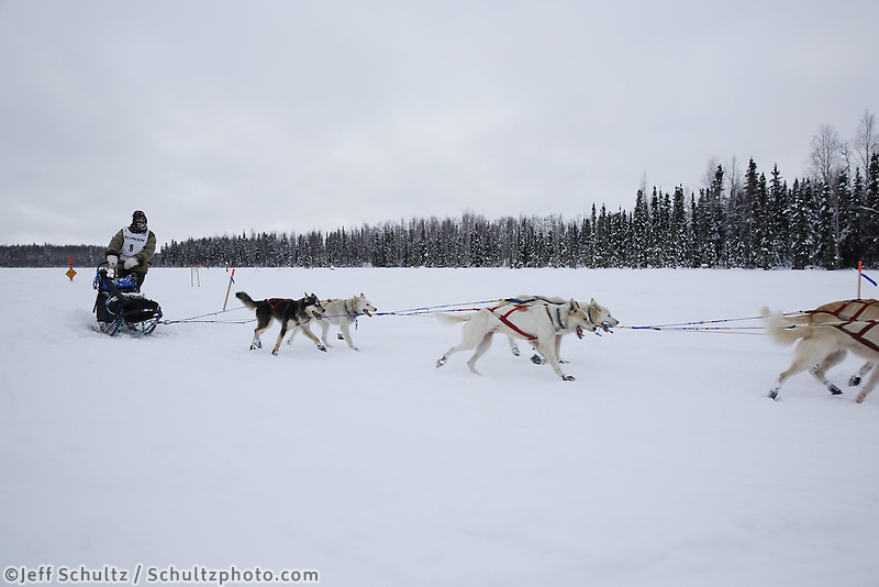 Jimmy Lanier runs on the trail nearing the finish of the 2013 Junior Iditarod.  Willow Alaska..Photo by Jeff Schultz/IditarodPhotos.com   Reproduction prohibited without written permission