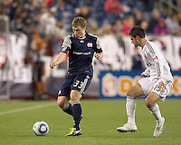 New England Revolution midfielder Zak Boggs (33) dribbles as Vancouver Whitecaps FC defender Blake Wagner (19) defends. In a Major League Soccer (MLS) match, the New England Revolution defeated the Vancouver Whitecaps FC, 1-0, at Gillette Stadium on May14, 2011.