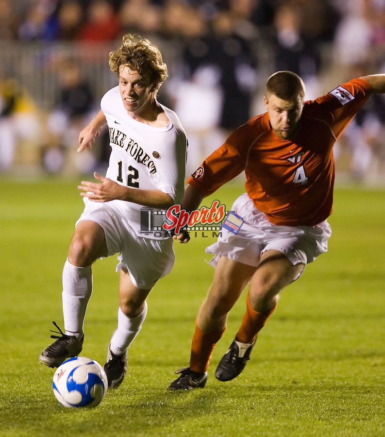 Zack Shilawski (12) is held by James Shupp (4) of the Virginia Tech Hokies during semi-final action of the 2007 NCAA Men's College Cup at SAS Soccer Park in Cary, NC, Friday, December 14, 2007.  The Demon Deacons defeated the Hokies 2-0 to advance to the finals versus Ohio State.