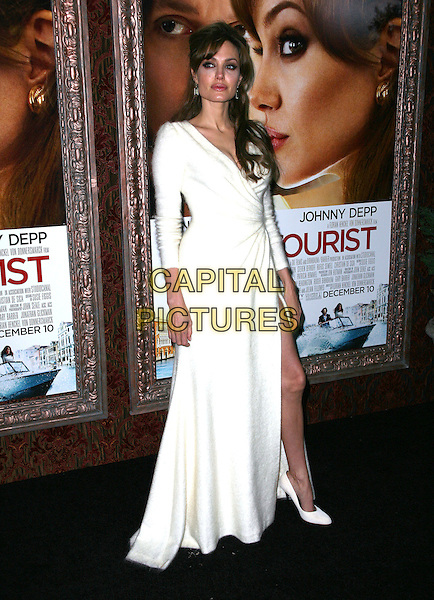 06 December 2010 - New York, NY - Angelina Jolie.  World premiere of 'The Tourist' at Ziegfeld Theatre on December 6, 2010 in New York City.  .CAP/ADM/PZ.©Paul Zimmerman/AdMedia/Capital Pictures..CAP/ADM/PZ.©Paul Zimmerman/AdMedia/Capital Pictures.