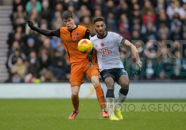 Liam McAlinden of Wolves competes with Ryan Shottyon of Derby - Football - Sky Bet Championship - Derby County vs Wolverhampton Wanderers - iPro Stadium Derby - Season 2014/15 - 8th November 2014 - Photo Malcolm Couzens/Sportimage
