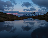 Twilight mountain reflection in small mountain pond, Moskenesøy, Lofoten Islands, Norway