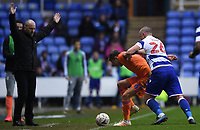 25th January 2020; Madejski Stadium, Reading, Berkshire, England; English FA Cup Football, Reading versus Cardiff City; Charlie Adam of Reading competes for the ball with Will Vaulks of Cardiff City in front of Mark Bowen Manager of Reading