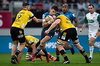 14th June 2020, Aukland, New Zealand;  Blues fullback Beauden Barrett is held up during the Investec Super Rugby Aotearoa match, between the Blues and Hurricanes held at Eden Park, Auckland, New Zealand.