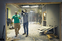 Hunter Bailey (left), Christ Community Church lead pastor, and church member Chris Berry help Saturday, Jan. 11, 2020, while doing interior demolition with other church members at 101 W. Mountain Street on the Fayetteville square. <br /> <br /> Christ Community Church purchased the building and will work with Milestone Construction Company to renovate the space into their permanent home. Art Ventures NWA moved out of the building in December and the Fayetteville Farmers Market will keep their office in the building. <br /> <br /> The church formed six years ago, said Andrew Brill, director of operations, and currently rents space at Mount Sequoyah Retreat and Conference Center. They hope to move into the new space in August. <br /> <br /> The church uses multiple spaces spread across the Mount Sequoyah campus, said Brill, and they wanted a location with everything under one roof. Brill and Bailey both said that the church wanted to be closer to the heart of Fayetteville. Bailey said that he wants people to know the building is 'Still a community place - a place that serves Fayetteville.' <br /> <br /> Check out nwaonline.com/200112Daily/ for today's photo gallery.<br /> (NWA Democrat-Gazette/Ben Goff)