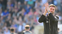 Lincoln City's first team coach/under 23 manager Jamie McCombe applauds the fans at the final whistle<br /> <br /> Photographer Chris Vaughan/CameraSport<br /> <br /> The EFL Sky Bet League Two - Carlisle United v Lincoln City - Friday 19th April 2019 - Brunton Park - Carlisle<br /> <br /> World Copyright © 2019 CameraSport. All rights reserved. 43 Linden Ave. Countesthorpe. Leicester. England. LE8 5PG - Tel: +44 (0) 116 277 4147 - admin@camerasport.com - www.camerasport.com