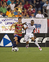 Monarcas Morelia forward Luis Gabriel Rey (18) with the ball as New England Revolution defender Darrius Barnes (25) defends. Monarcas Morelia defeated the New England Revolution, 2-1, in the SuperLiga 2010 Final at Gillette Stadium on September 1, 2010.